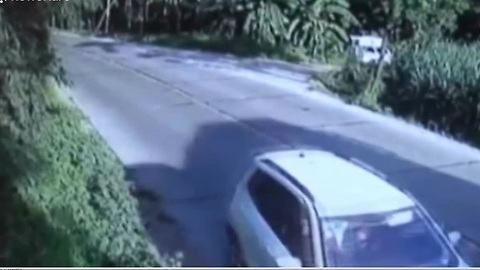 Car Narrowly Escapes Being Crushed When Truck Flips
