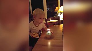 Little Boy Can't Wait To Blow Out His Birthday Candles