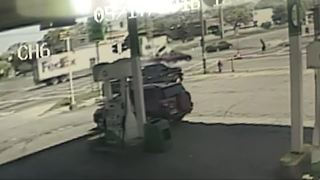 Surveillance video shows truck slam into van