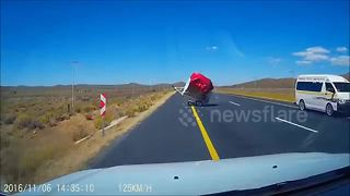 Trailer blown by wind smashes oncoming car windscreen - Video