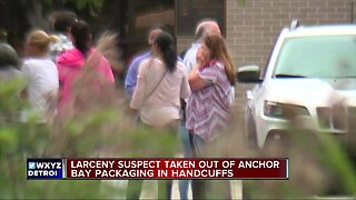 Larceny suspect taken out of Anchor Bay Packaging in handcuffs