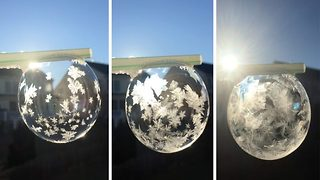 Mesmerising moment bubble freezes creating stunning 'snow globe' effect - Video