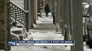 Overnight snow surprises Kenosha County village - Video
