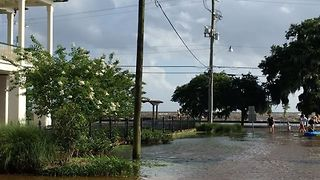 High Tide Causes Floodwaters to Reach Buildings Along Mandeville Lakefront - Video