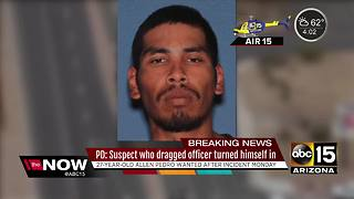 Suspect who dragged officer turns himself in - Video