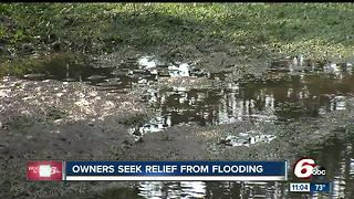 Kokomo home owners seek relief from flooding - Video