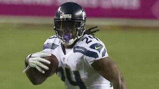 NFL player Marshawn Lynch hands out masks!