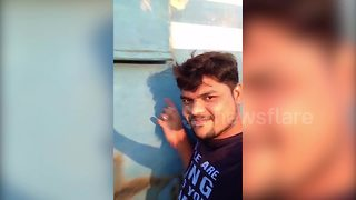 Indian man hit by train while posing for selfie in stupid stunt - Video