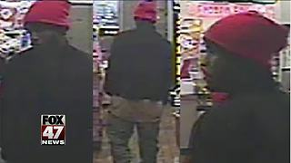 Lansing police released surveillance photo of armed robbery suspect - Video
