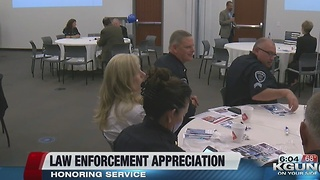 Police officer widows move forward through service - Video