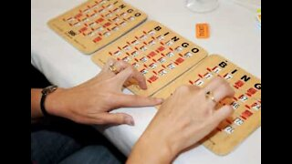Neighbors play bingo while maintaining social distancing