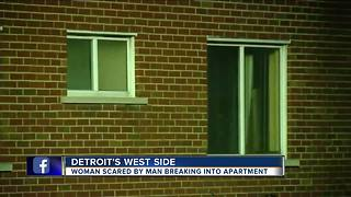 Woman scared by man breaking into apartment - Video