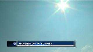 Warm fall temperatures prompt need to stay cool - Video