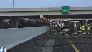 Semi flips off of I-75, crashes onto Fowler Avenue during morning commute - Video