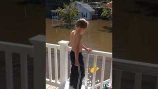 Family In Windsor Catches Fish In Floodwaters - Video