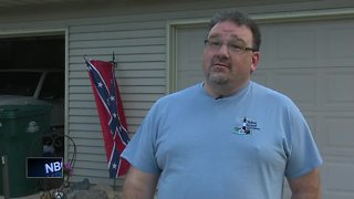 Howard man decides to move Confederate flag indoors - Video