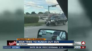 South Florida man punches SUV in road rage case - Video