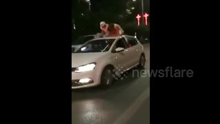 Man comforts woman on top of moving car after she broke up with her boyfriend - Video