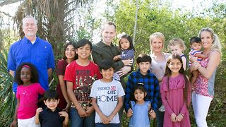 Family adopt nine children in one go so that all the siblings can stay together - Video
