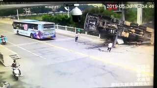 Men escape death after large crane flips over in China's Jiangxi