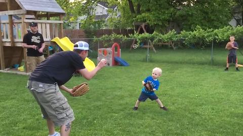 A Tot Boy Struggles To Balance As He Plays Catch With His Uncle