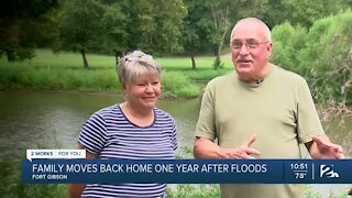 Family moves back home one year after floods
