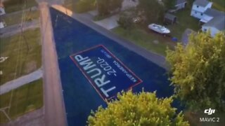 Man paints lawn with Trump sign