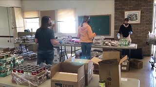 Food pantry creates drive-through for increase in families