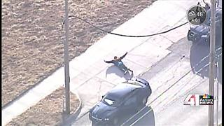 Police chase through downtown Kansas City ends as subject surrenders - Video