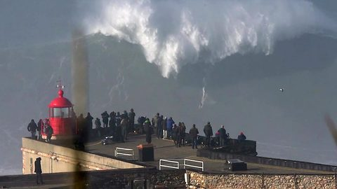 Would you ride this wave? Surfer takes on giant wave in Portugal