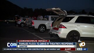 Families flock to drive-in theatre's reopening