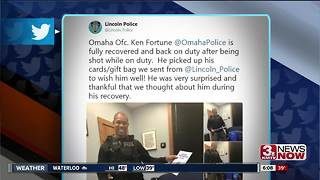 Omaha Police officer returns to duty after being shot last month