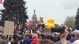 Saint Petersburg Crowd Bounces Around Giant Inflatable Rubber Duck as a Symbol of Protest