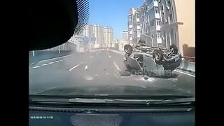 Minivan rear-ended and rolls over on highway