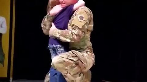 School Stage Becomes A Place Where Sergeant And Daughter Share A Hug