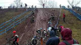 Several Cyclists Continuously Slide Down Muddy Hill