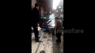 Out-of-control car ploughs into pedestrian - Video