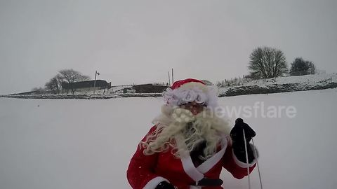 Santa goes sledging in snowy Buxton, UK