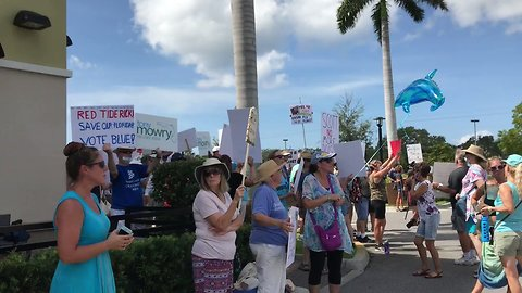 Rick Scott Met by 'Red Tide' Protesters During Appearance in Venice