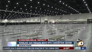 Homeless San Diegans move into convention center