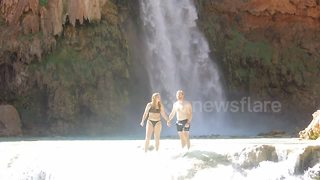 Romantic Waterfall Proposal Does Not Go As Planned  - Video