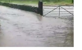 Floodwater Rushes Down Roads in Cumbria - Video
