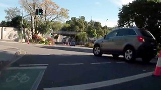 Wheelie bad! Cyclist captures moment driver crashes crowd of racing riders