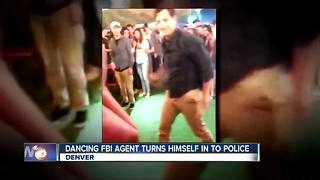 Dancing FBI agent who shot person turns himself in - Video