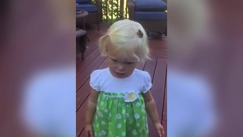 Funny Tot Girl Has A Frog On Her Head