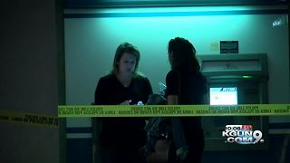 Police investigating armed robbery at credit union - Video