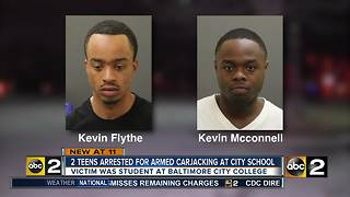 Two men arrested for carjacking teen in school parking lot - Video