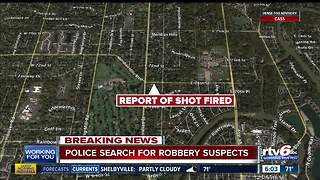 Shot fired as police search for suspects after CVS robbery - Video