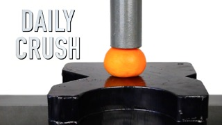 Crushing an orange with a hydraulic press! - Video