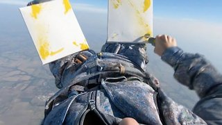 Artistic daredevil paints while skydiving
